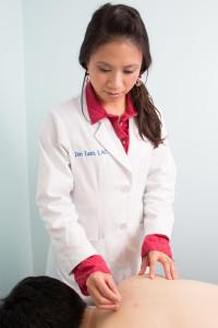 Zen Tuan, Pasadena acupuncturist, demonstrating acupuncture