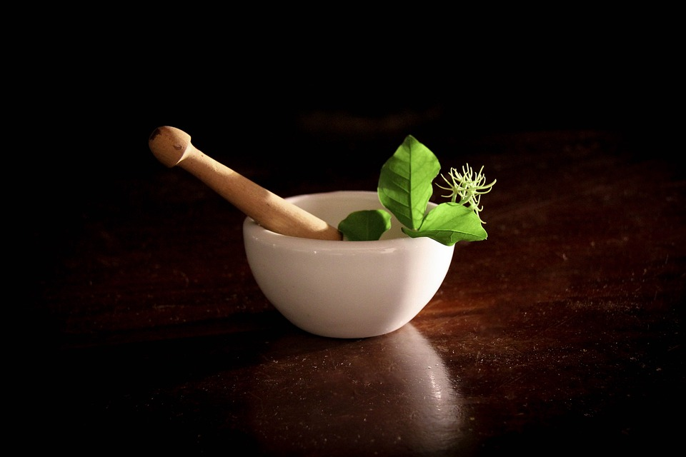 Image of herbs in bowl for herbal therapy