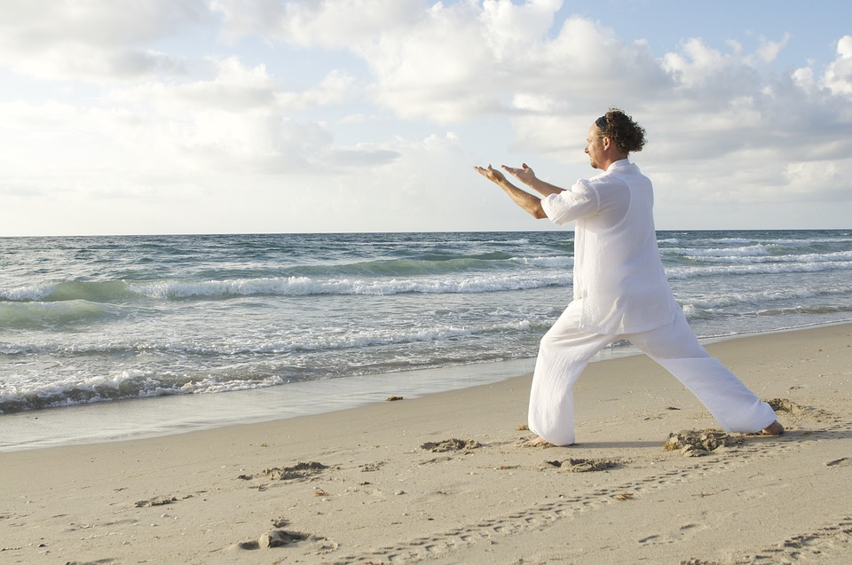 Photo of man practicing qigong